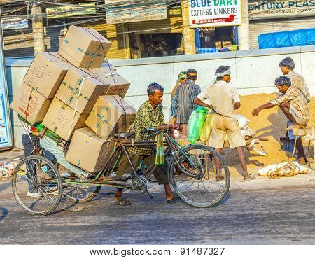 Rickshaw Rider Transports Heavy Goods Early Morning