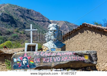 LA HIGUERA BOLIVIA - AUGUST 6 2014: Monument to the revolutionary Che Guevara La Higuera Bolivia seen on August 8 2014. Guevara was executed in La Higuera on October 8 1967 poster