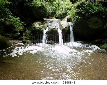 The Schiessentuempel waterfall in Mullerthal, Luxembourg