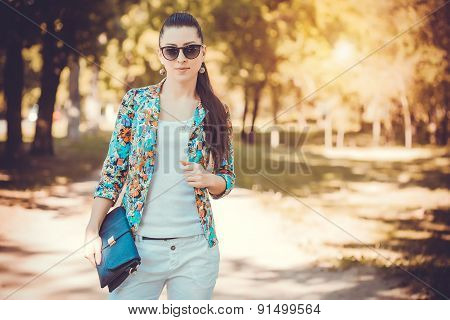 pretty young woman in a summer park