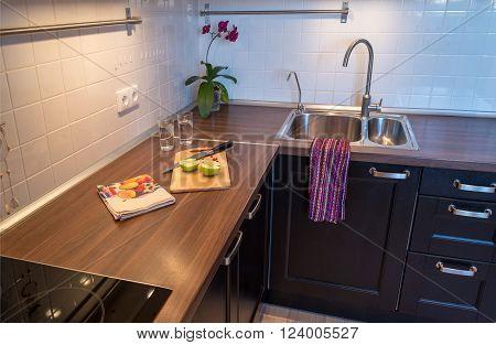modern dark kitchen interior with food details