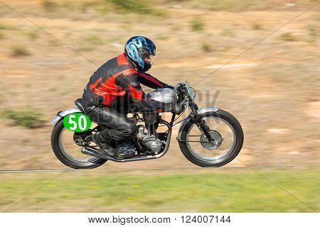 BROADFORD VICTORIA/AUSTRALIA - APRIL 1 2016: Classic bikes practice at Broadford Racetrack before the 2016 Shannons Victorian Historic Road Racing Championship.