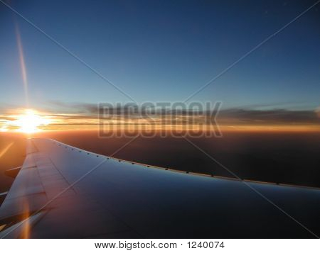 Sunset Over Airplane Wing