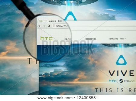 MONTREAL CANADA - MARCH 25 2016 - HTC internet page under magnifying glass. HTC Corporation is a Taiwanese multinational manufacturer of smartphones and tablets.