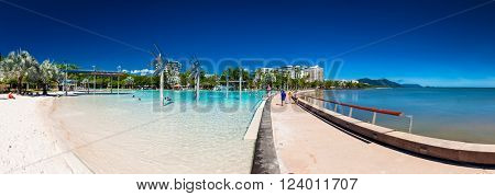 CAIRNS, AUSTRALIA - 27 MARCH 2016. The Esplanade in Cairns with swimming lagoon and the ocean, Queensland, Australia.