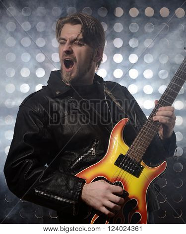 rock guitarist playing electric guitar in fog poster
