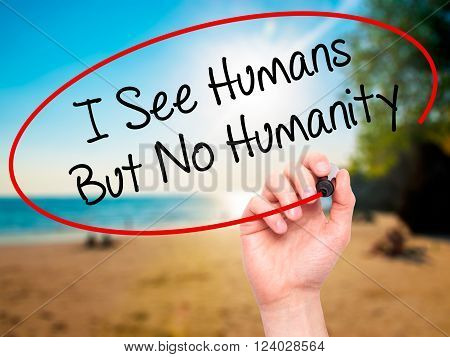 Man Hand Writing I See Humans But No Humanity With Black Marker On Visual Screen.