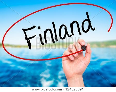 Man Hand Writing Finland With Black Marker On Visual Screen.