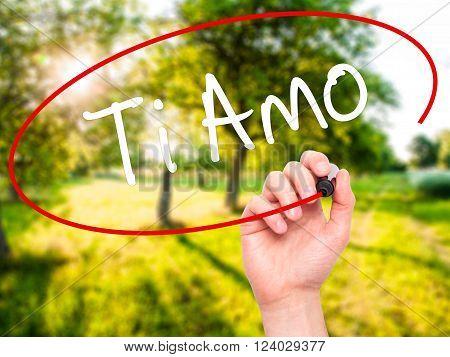 Man Hand Writing Ti Amo (i Love You In Italian) With Black Marker On Visual Screen.