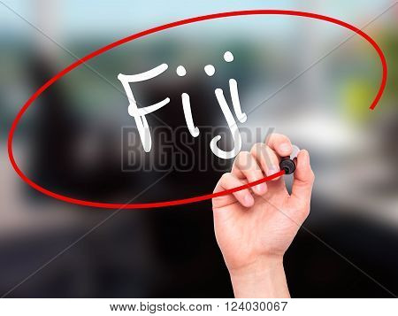 Man Hand Writing Fiji  With Black Marker On Visual Screen.