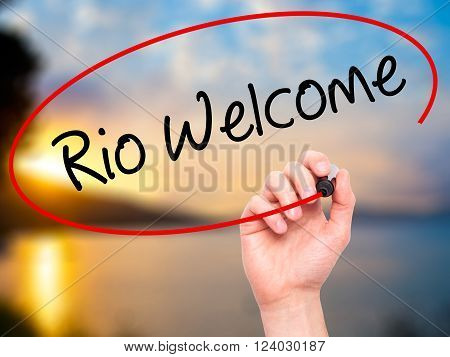 Man Hand Writing Rio Welcome With Black Marker On Visual Screen.