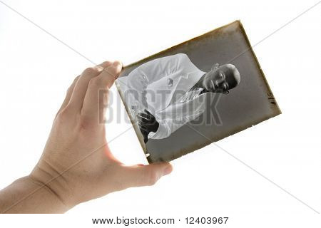 silver-gelatin  glass plate negative in the hand
