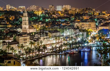 Aerial view on night panorama of old historic town of Split, Croatia. Town with beautiful architecture and history that attracts many tourists each summer.