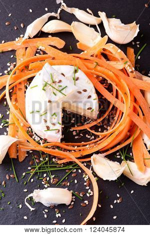 Top View On Portion Of Camembert With Garlic And Carrot