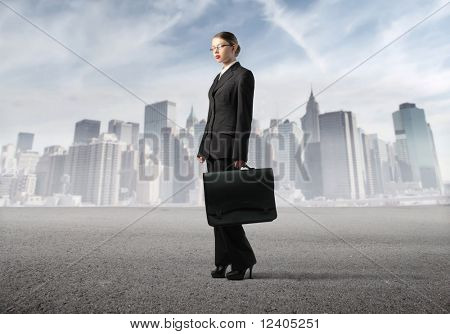 Businesswoman with cityscape on the background