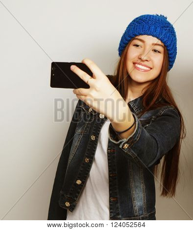 Girl take a self portrait with her smart phone