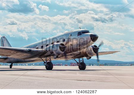 Dakota Douglas C 47 transport old plane boarded on the runway summer