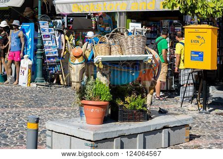 THIRA, SANTORINI, GREECE - AUGUST 26, 2015: Sculpture of donkey as decoration of main street of Thira town.