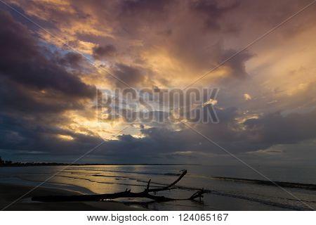 Dramatic sunset on the ocean. Clouds illuminated by sun .Fiji.