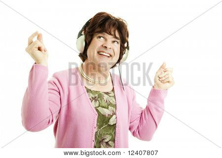 Funny photo of a female impersonator with headphones on, dancing to the music.  Isolated.