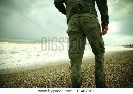 The person and the sea. The tourist on summer holiday. A beautiful sea landscape