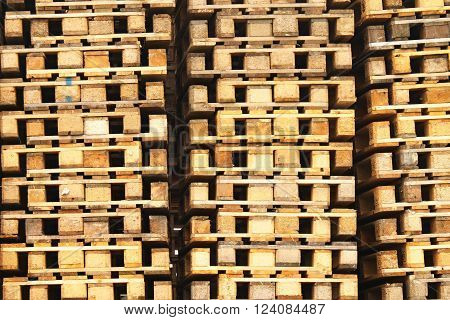 wooden euro pallets stocked outside at transportation company, stored pallets