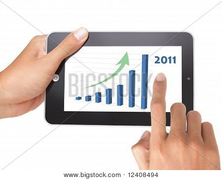 hand holding a touchpad tablet pc with growt chart
