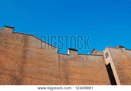 rough wall in clear blue sky
