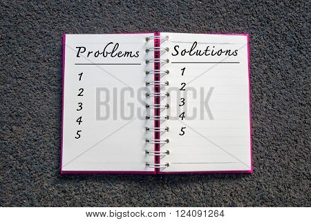 Problem and Solution Business Concept. Problems and solutions list in white notebook.