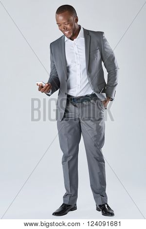 Black professional businessman in business formal attire on his mobile cell smartphone