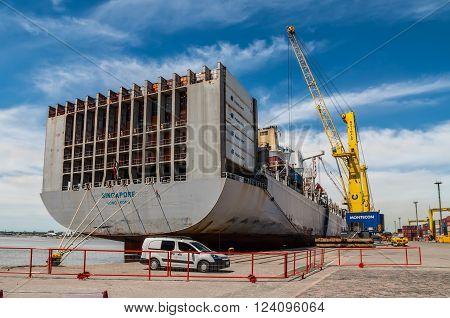 Montevideo, Uruguay - December 15, 2012: Container Ship OOCL Singapore loading containers at Montevideo port - Uruguay South America - Rio de la Plata.