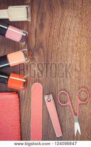 Vintage photo, Cosmetics and accessories for manicure or pedicure, nail file, nail polish, scissors, nail clippers, fluffy towel, concept of nail care, copy space for text
