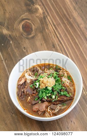Rice noodles with spicy pork sauce (Nam ngiao) is a noodle soup or curry of the cuisine of the Tai Yai people. Nam ngiao has a characteristic spicy and tangy flavor. thai food.