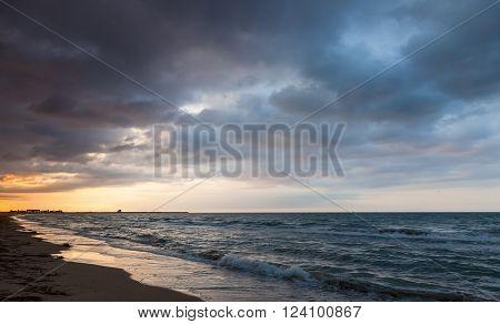 Dramatic colorful seascape Mediterranean sea coast at sunrise in Spanish resort town Calafell Tarragona region poster