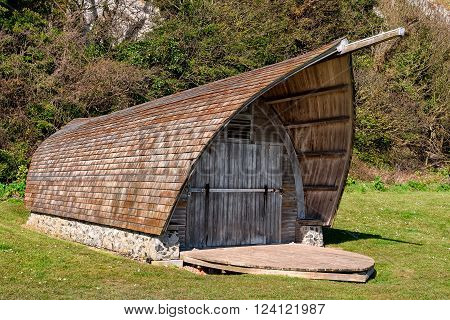 Old wooden boathouse at White Cliffs of Dover in Kent, England