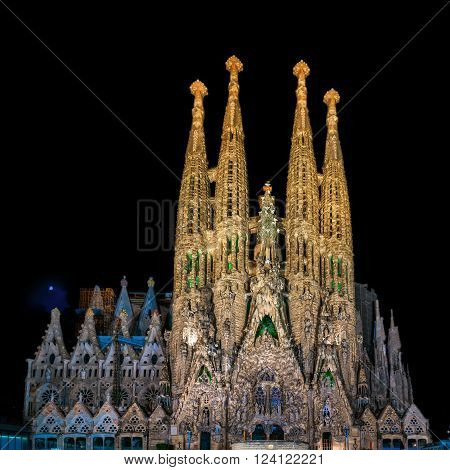 Barcelona, Spain - September 22, 2015: Nativity facade at basilica of La Sagrada Familia at night. It is designed by architect Antonio Gaudi and is being build since 1882.