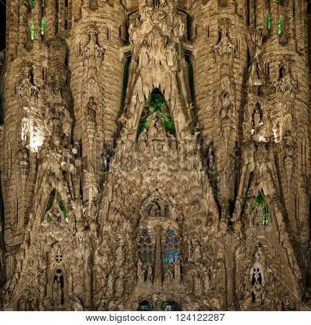 Barcelona, Spain - September 22, 2015: Close view to Nativity facade at basilica of La Sagrada Familia at night. It is designed by architect Antonio Gaudi and is being build since 1882.