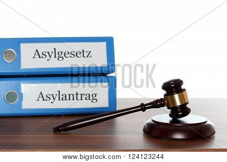 gavel on board and  folders with text:  asylum law and application for asylum