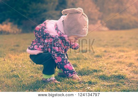 Little baby toddler exploring cold outside world in the evening