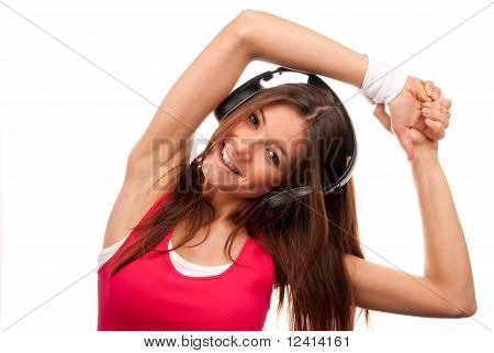 Pretty Fitness Brunette Woman Listening Music And Smiling