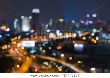 Abstract blurred light background, city downtown and highway interchange night view