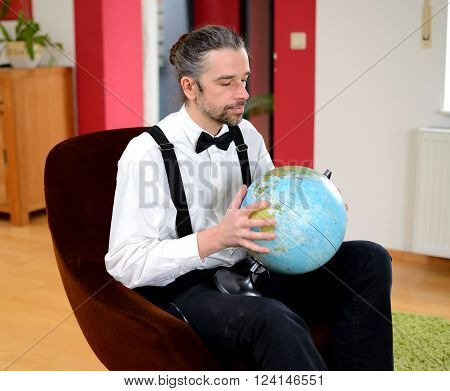 Man With  Terrestrial Globe In His Living Room
