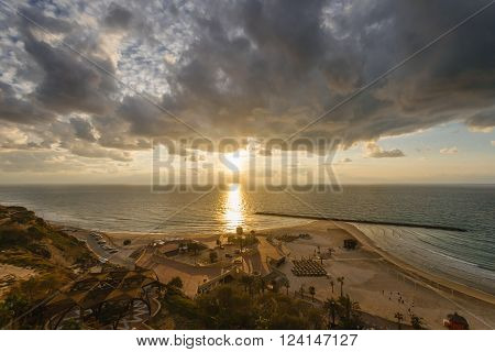 Sunset over the Mediterranean beach in Netanya Israel