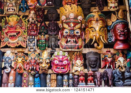 Colourful wooden masks and handicrafts on sale at street stall in the Thamel District of Kathmandu, Nepal.
