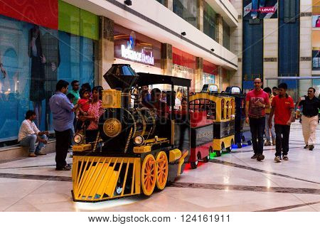 DELHI, INDIA, 22ND OCTOBER 2016 - Kids enjoying a toy train ride in a mall in Delhi Gurgaon. Many such entertainment options have opened up in malls to keep the kids engaged