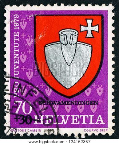 SWITZERLAND - CIRCA 1979: a stamp printed in the Switzerland shows Schwamendingen Communal Arms circa 1979