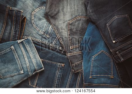 Fashion different jeans background. Retro toned photo.