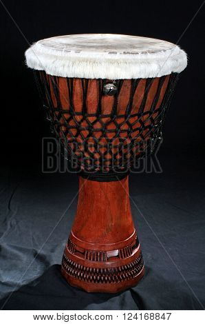 Djembe, a african drums on black background.