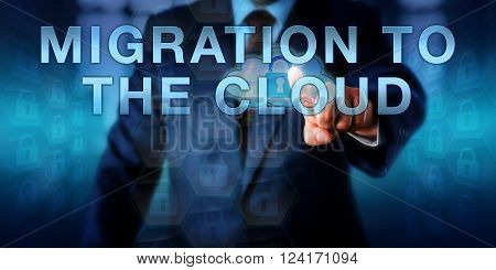 Corporate consultant is pressing MIGRATION TO THE CLOUD on a touch screen interface. Business metaphor and information technology concept for increase in enterprise wide cloud service integration.