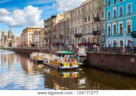 SAINT-PETERSBURG RUSSIA - AUGUST 5 2015: River cruise passenger boats moored on Griboedov channel in the historic city in sunny day